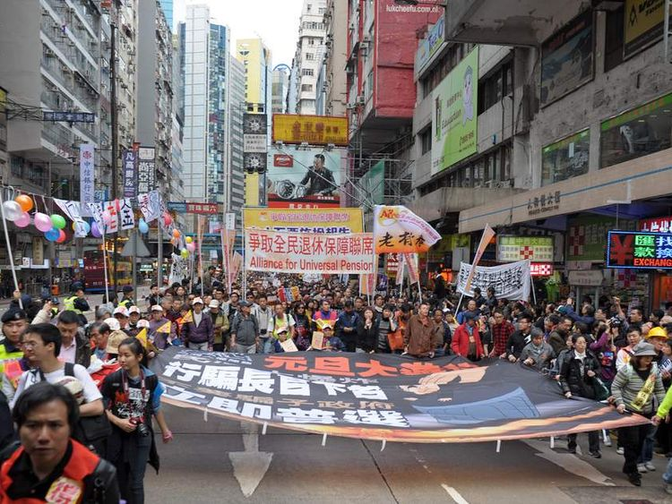 Thousands of pro-democracy protesters take to the streets in Hong Kong