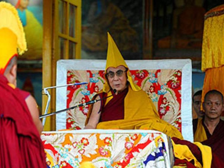 Tibetan Spiritual Leader The Dalai Lama (C) gestures as he addresses devotees during a teaching session at a Buddhist Temple in Dharamshala on March 19, 2011. The Dalai Lama's plan to retire and the Tibetan Parliament election is scheduled for March 20, when an estimated 85,000 Tibetans in exile in 13 countries select a new leader from a trio of candidates who are all secular, non-religious figures for the first time. AFP PHOTO/RAVEENDRAN (Photo credit should read RAVEENDRAN/AFP/Getty Images