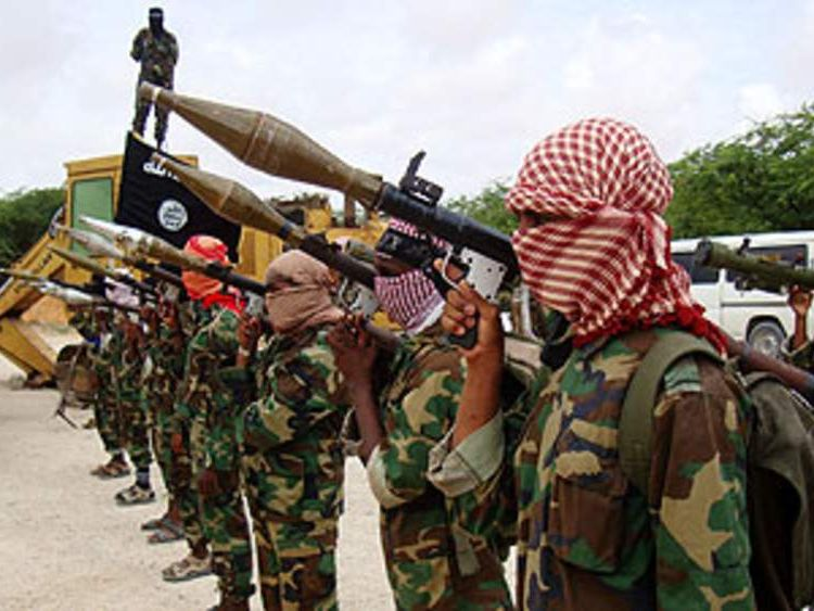 Militants belonging to Somalia's Al-Qaeda-inspired Shebab Islamists stand in formation on October 21 2010 during a show of force in Somalia's capital Mogadishu.