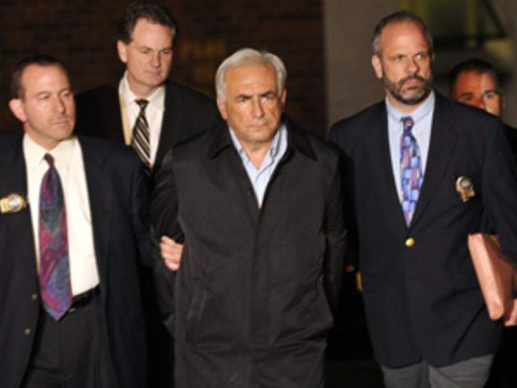 Former IMF chief Dominique Strauss-Kahn is led out of a police station.
