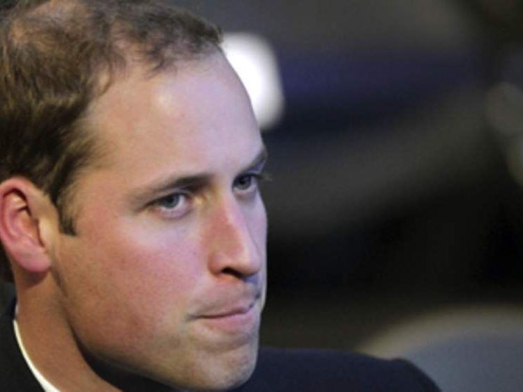 Britain's Prince William reacts after FIFA President Sepp Blatter (unseen) announced on December 2, 2010 in Zurich that Russia will host the 2018 World Cup.