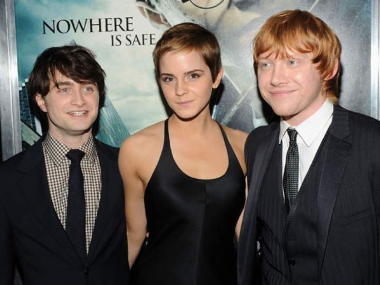 Actors Daniel Radcliffe, Emma Watson and Rupert Grint attend the premiere of Harry Potter and the Deathly Hallows - Part 1