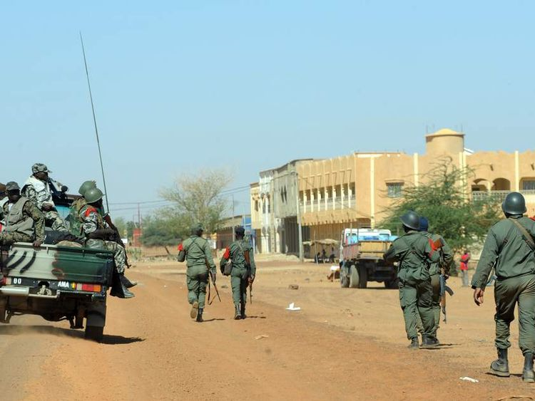 Troops patrol a street in the city of Gao, Mali