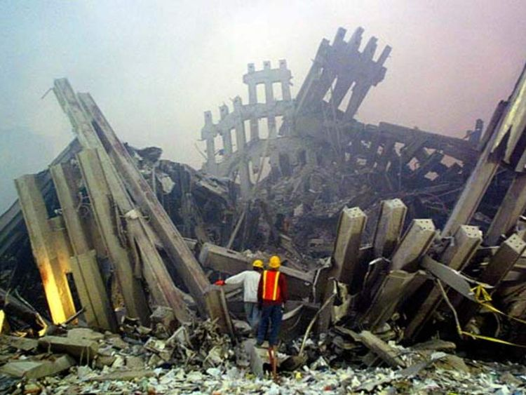 Rescue workers survey damage to the World Trade Center 11 September, 2001
