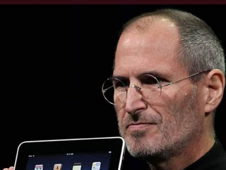 Steve Jobs holds up the new iPad as he speaks during an Apple Special Event January 27, 2010