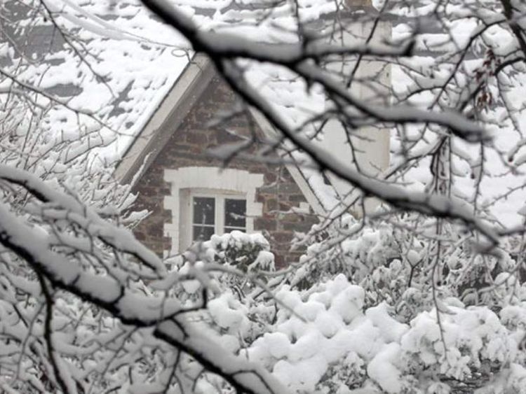 Snow covers a house in Dulverton as a cold snap grips the UK, January 30, 2012