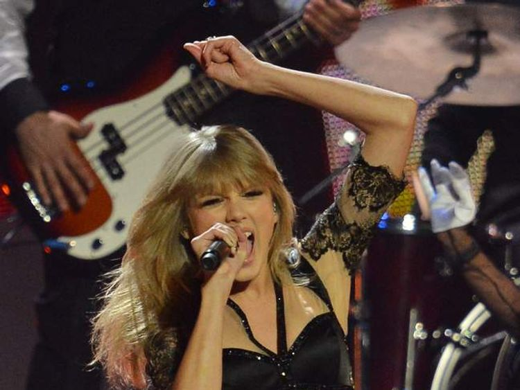 Taylor Swift performs on stage at the Brit Awards 2013