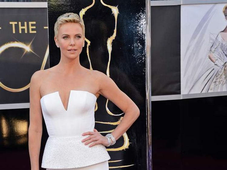 Charlize Theron arrives at the Oscars