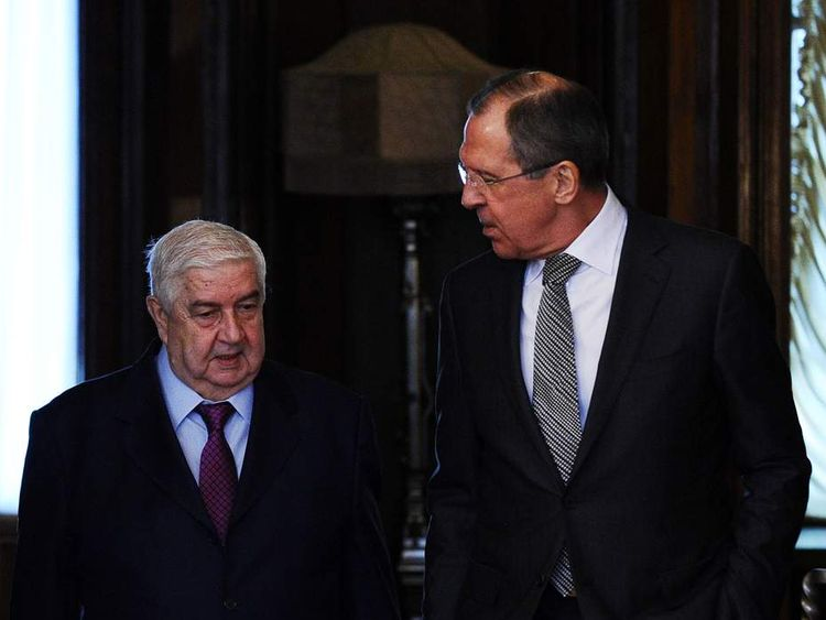 Russian Foreign Minister Sergei Lavrov (R) speaks with his Syrian counterpart Walid al-Muallem during their meeting in Moscow on February 25, 2013. The regime of Syrian President Bashar al-Assad is ready to talk with all parties, including armed groups, who want dialogue to end the conflict, Walid al-Muallem said today at the start of talks with Lavrov. AFP PHOTO / YURI KADOBNOV (Photo credit should read YURI KADOBNOV/AFP/Getty Images)