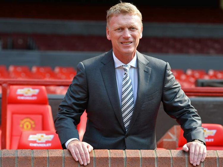 Manchester United's new manager David Moyes poses for photographers at Old Trafford.