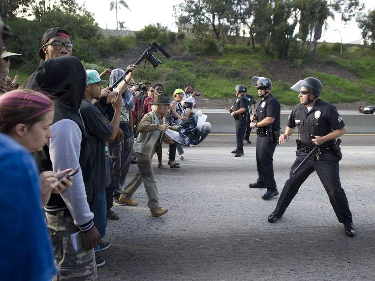 Protesters in the US clash with police as George Zimmerman is cleared.