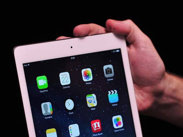An Apple employee shows off the new iPad Air in London