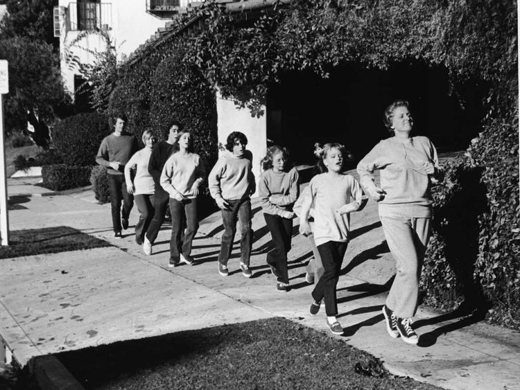 Ann B Davis leads the Brady family in a rigorous jog