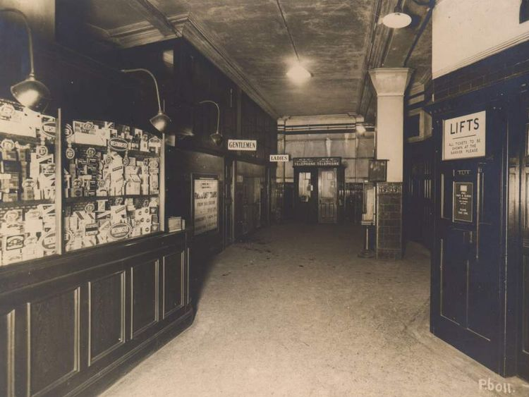 The booking hall and tobacconist's kiosk at Brompton Road tube station in 1927