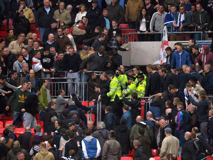 Police move in as fans clash