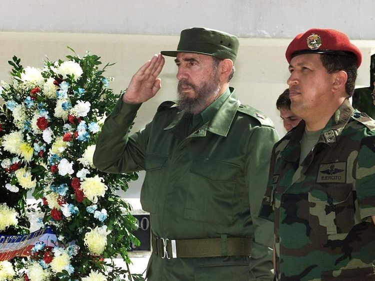 The Cuban President Fidel Castro (L) and
