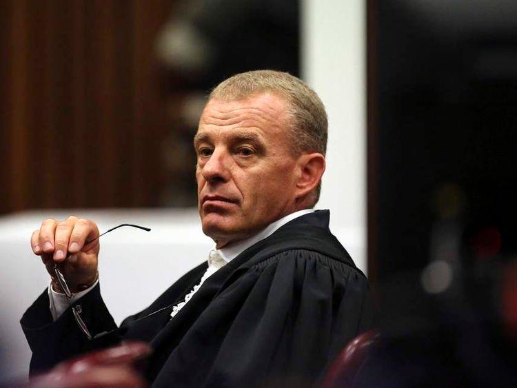 State prosecutor Gerrie Nel gestures as he cross-examines Oscar Pistorius in Pretoria
