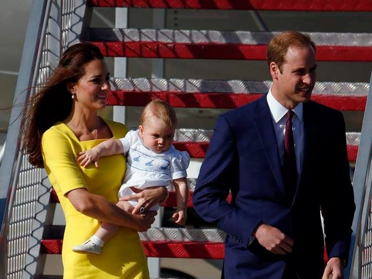 Britain's Prince William and his wife Catherine, the Duchess of Cambridge, arrive with their son Prince George at Sydney Airport