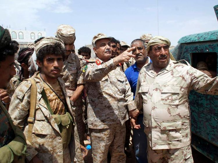 Yemen's Defence Minister Major General Muhammad Nasir Ahmad gestures as he visits Mayfaa, in the southeastern province of Shabwa.