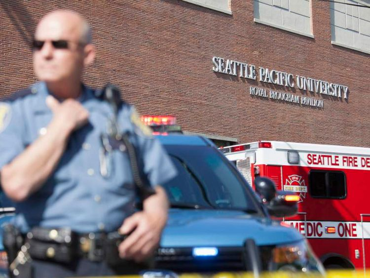 A policeman stands guard at Seattle Pacific University after the campus was evacuated due to a shooting in Seattle, Washington.