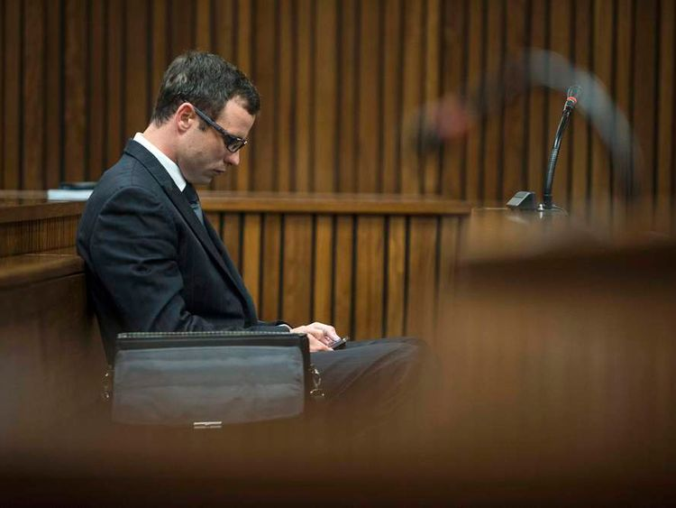 South African Olympic and Paralympic sprinter Oscar Pistorius sits in the dock at the North Gauteng High Court in Pretoria