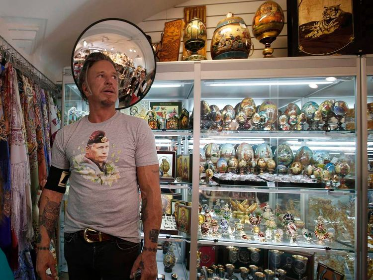 Actor Rourke wears a T-shirt with an image depicting Russia's President Vladimir Putin, as he visits a souvenir shop at GUM department store in central Moscow