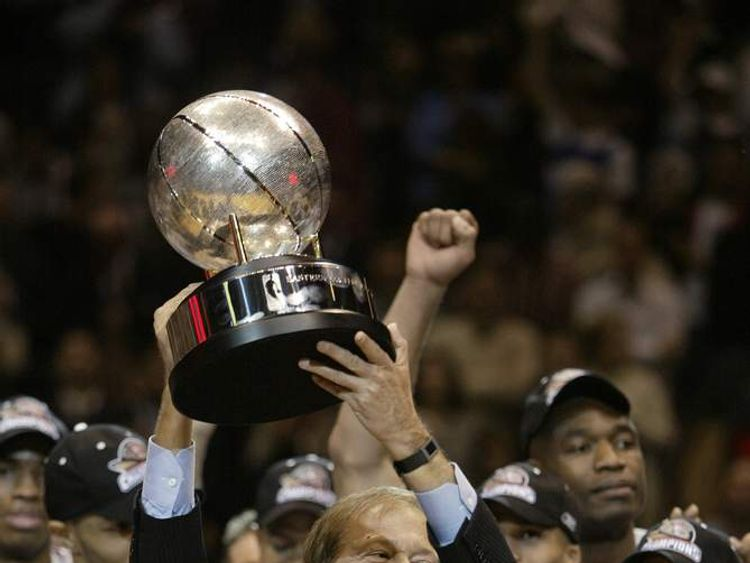 The New Jersey Nets owner Lewis Katz holds up the Eastern Conference Championship trophy after Game four of the Eastern Conference Finals during the 2003 NBA Playoffs