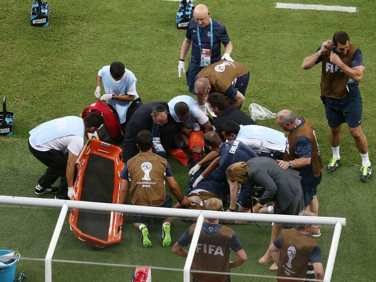 England physio Gary Lewin is treated after breaking and dislocating his ankle while celebrating a goal.