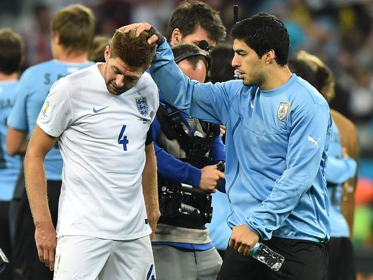 Suarez consoles Liverpool teammate Steven Gerrard after the game
