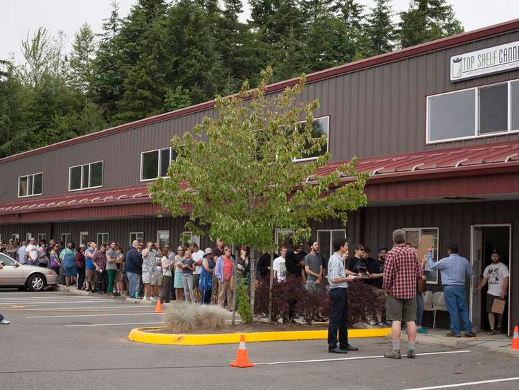 Customers wait in line at Top Shelf Cannabis, a retail marijuana store, on July 8, 2014 in Bellingham, Washington.