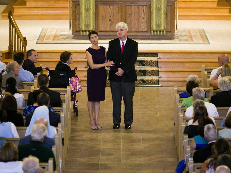 Diane and John Foley, parents of James Foley, address the congregation during a Catholic mass at Our Lady of the Holy Rosary.