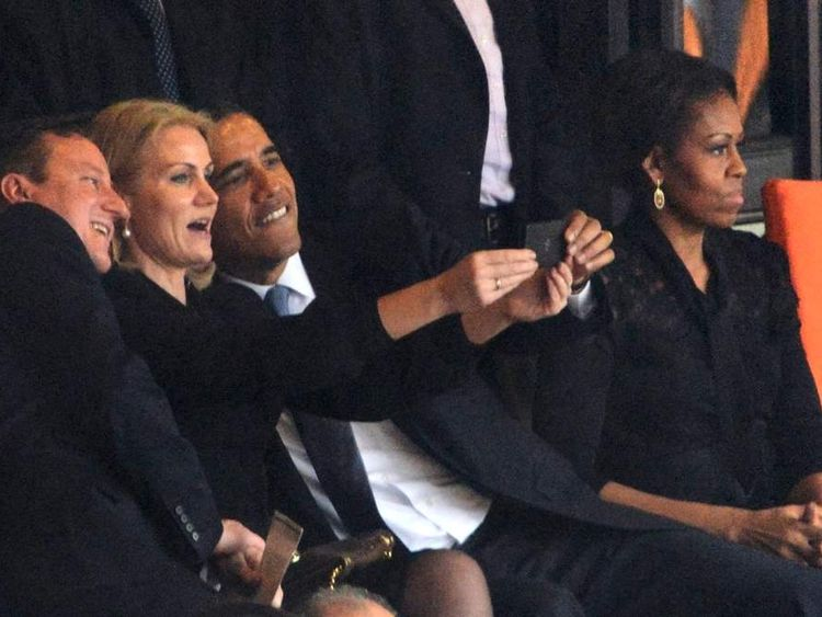 Barack Obama and David Cameron pose for a selfie at Nelson Mandela's memorial service