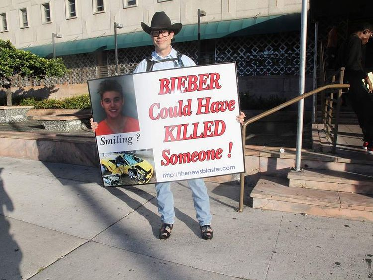 A protestor outside Bieber's court hearing