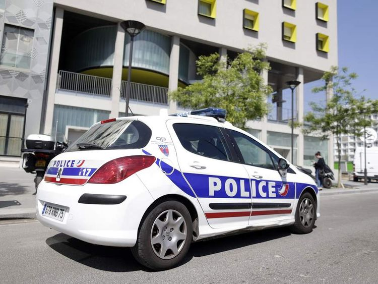A police vehicle is parked outside the student residence where an It student, suspected of planning a church attack in France, lived in Paris