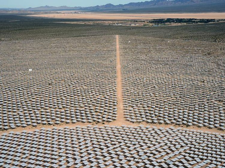 Heliostats at the Ivanpah Solar Electric Generating System are seen from above with the Primm Valley Golf Club in the distance.