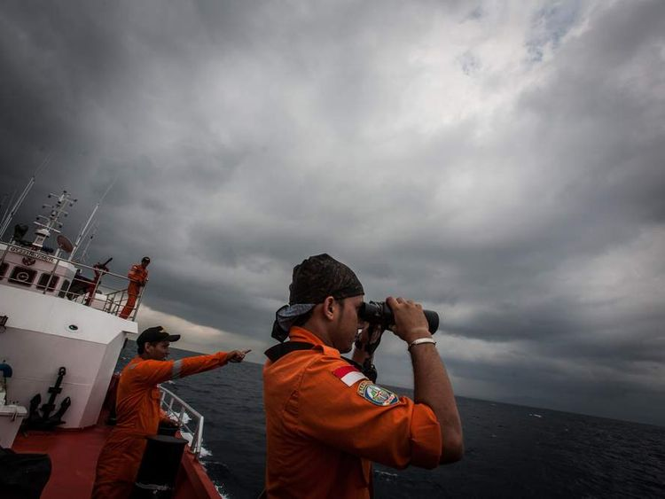 Indonesian national search and rescue agency personel watch over high seas