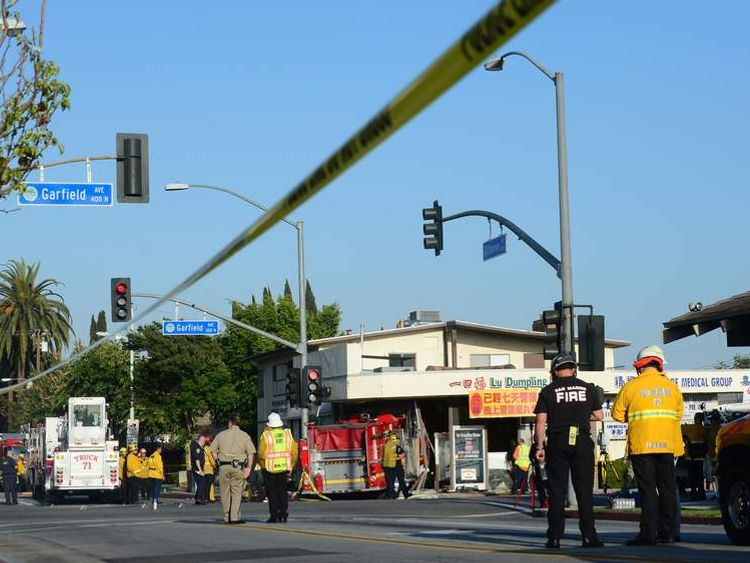 An intersection is closed off in Monterey Park, California, where two fire engines chasing a fire crashed into each other.