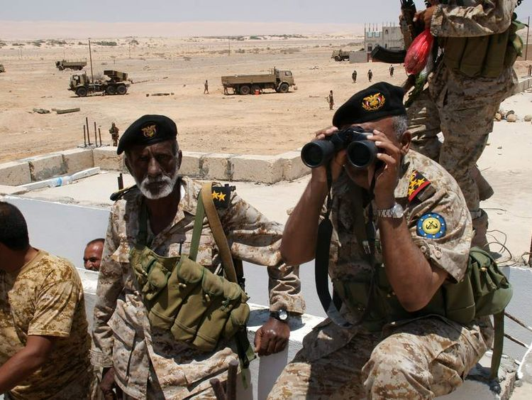 Yemeni troops scout their surroundings at a base in Raida, in Shabwa province, in southern Yemen on May 1, 2014.