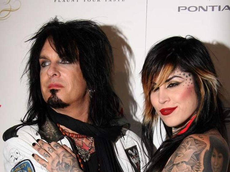 Motley Crue bassist Nikki Sixx and tattooist Kat Von D at Maxim's Hot 100 party