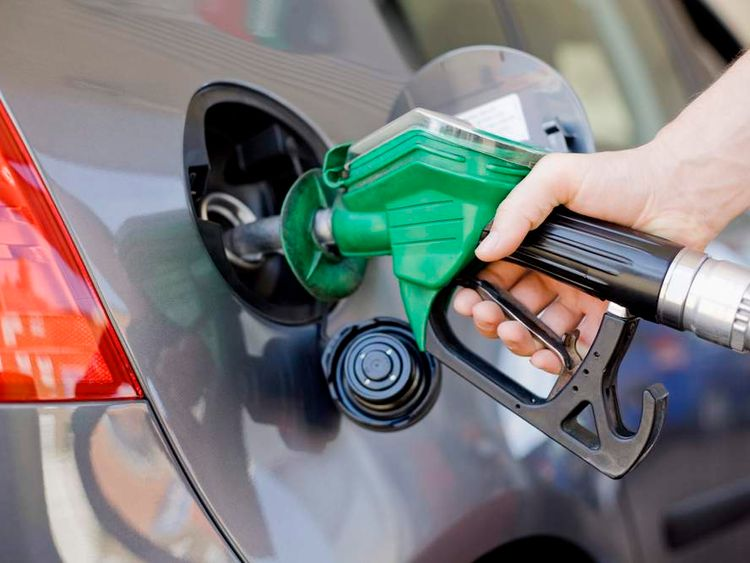 A car being filled with petrol