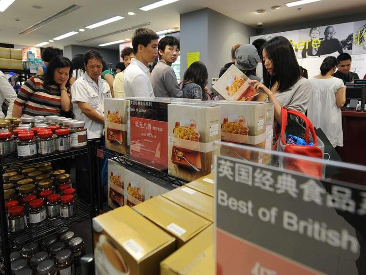 Chinese shoppers queue in Shanghai at a Marks & Spencer store