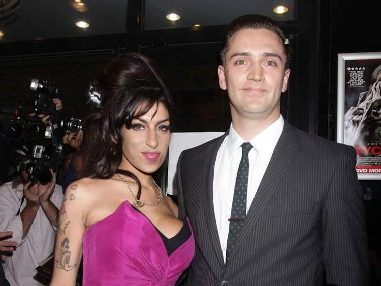 Amy Winehouse and boyfriend Reg Traviss