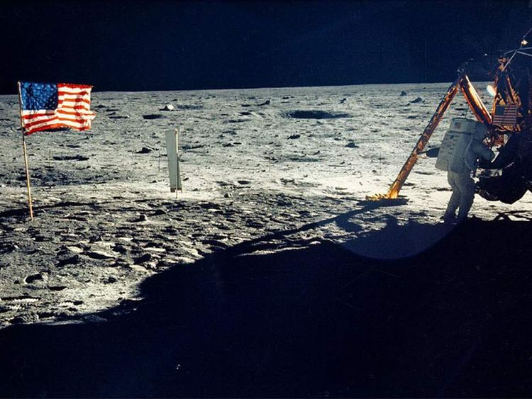 A rare photo of Neil Armstrong on the moon shows him working on his space craft
