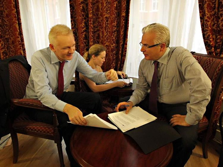 Julian Assange with legal adviser Balthasar Garcon (R) in Ecudorian embassy in London