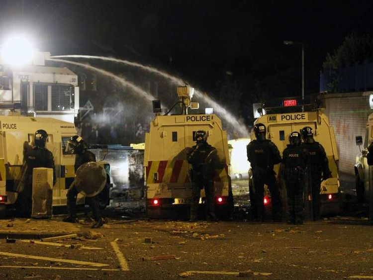 Police use a water cannon on loyalist rioters in North Belfast, Northern Ireland