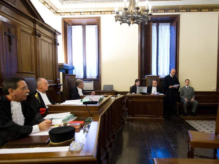 In this photo released by the Vatican paper L'Osservatore Romano, pope's butler Paolo Gabriele, right, sits in the wood-trimmed courtroom of the Vatican tribunal, at the Vatican, Saturday, Sept. 29, 2012.