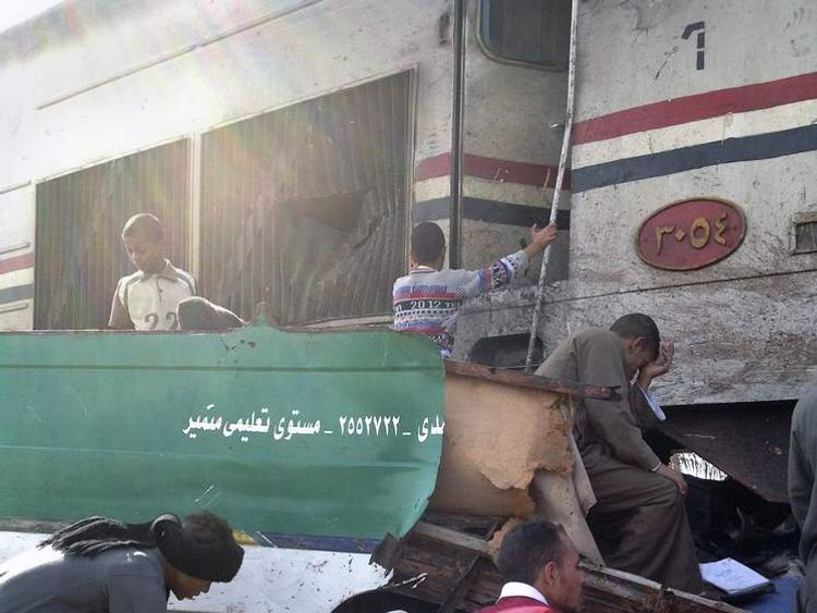 Distraught Egyptians searched for signs of their loved ones in the wreckage of a train crash that killed at least 47 people, most of them children near Assiut  in southern Egypt, Saturday, Nov. 17, 2012.