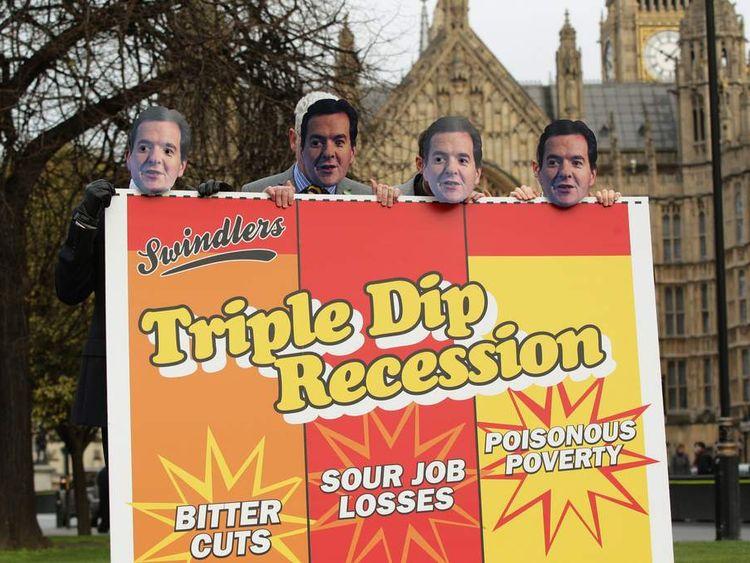 Protesters in George Osborne masks