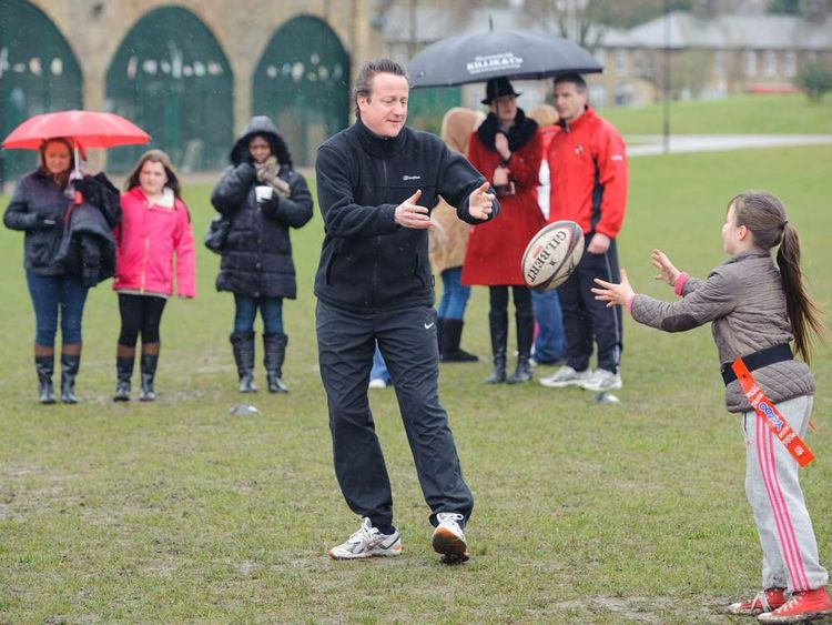 David Cameron playing rugby with schoolchildren