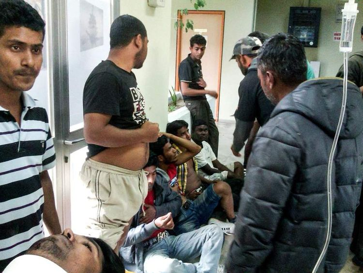 GREECE Shooting 2unidentified migrant workers receive first aid at the Medical Center of Varda, in Greece. At least 20 migrant strawberry pickers, most of them from Bangladesh, were shot and wounded in southern Greece on Wednesday, in a pay dispute after a foreman opened fire on them with a shotgun